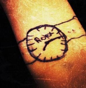 rolex tattoo on hand