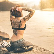 woman with short hair and tattoo